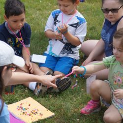 Red group working on friendship bracelets